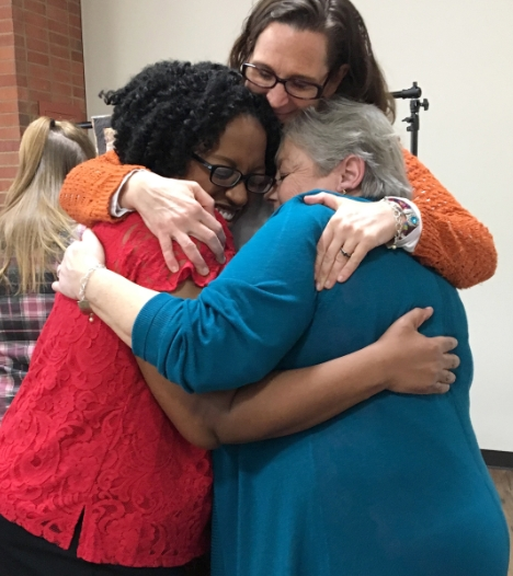 three women embracing each other